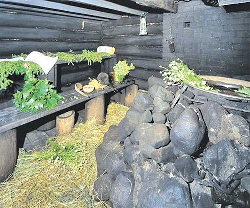 Атрибут бани по-чёрному - чёрные камни в печи