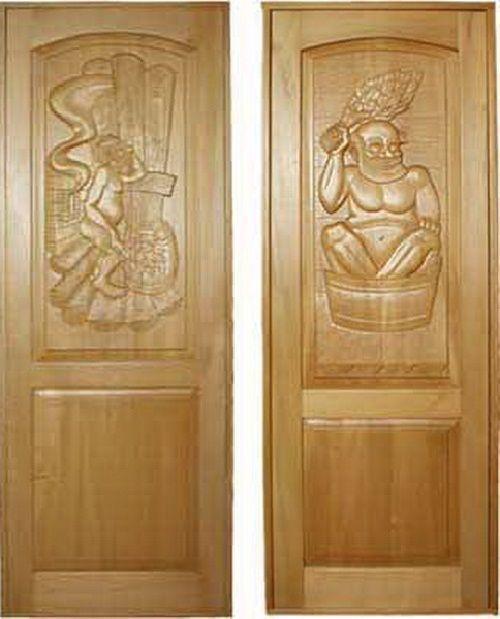 Металлические двери, покрытые резным деревом